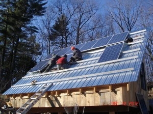 Photovoltaic Panels being installed on Barn